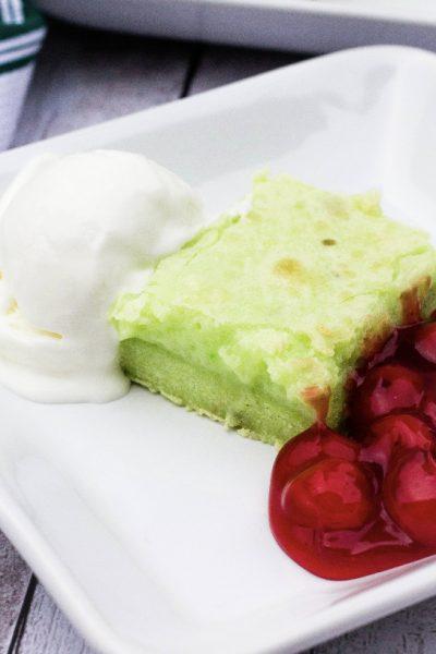 pistachio ooey gooey bar servfed with cherries and ice cream