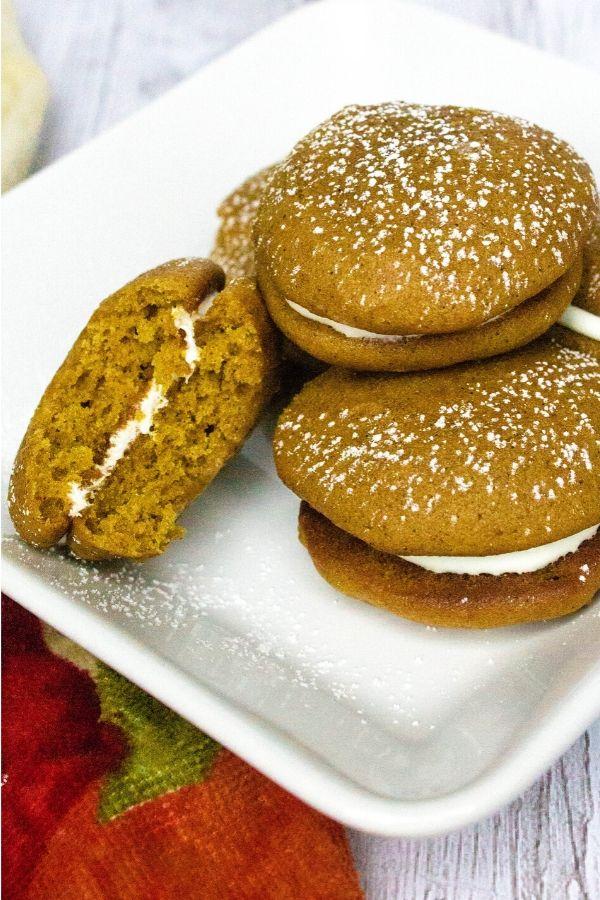 plate filled with pumpkin whoopie pie cookies