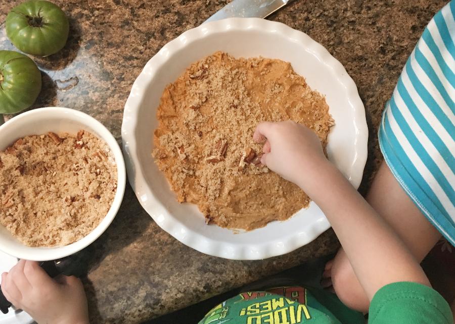 kids helping to assemble pumpkin pecan cobbler