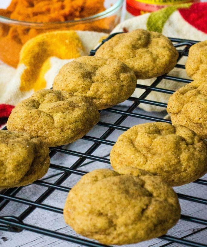 pumpkin snickerdoodle cookies cooling on a rack