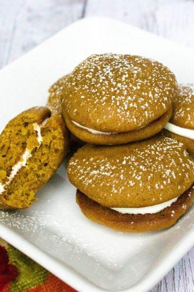 pumpkin whoopie pies on a plate