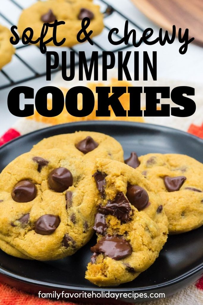 black plate with a few pumpkin chocolate chip cookies on it