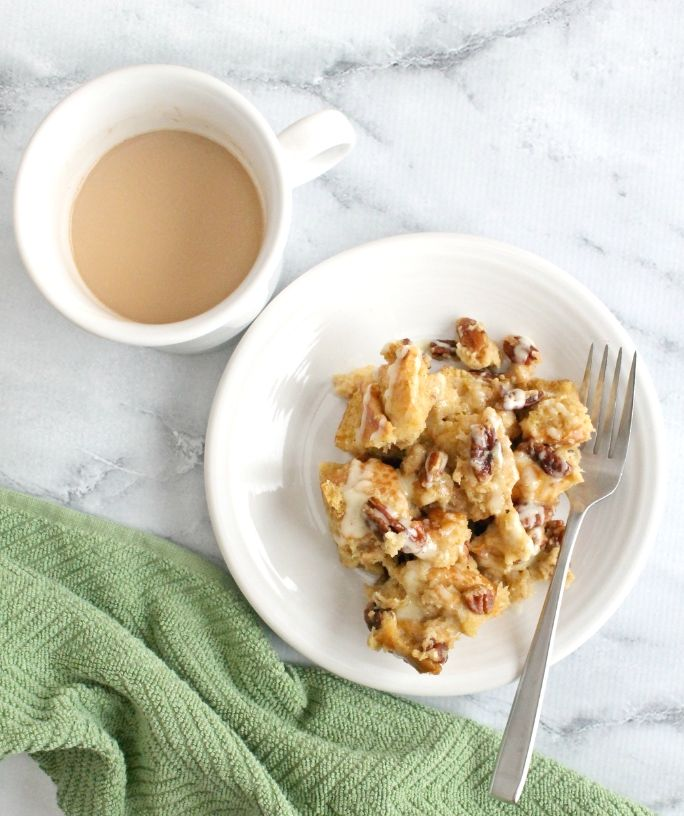 plate of eggnog french toast next to a cup of coffee