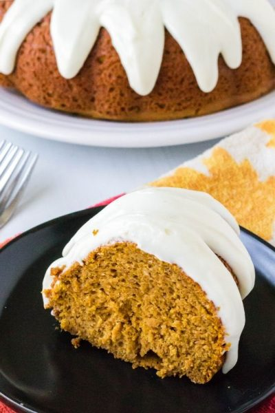 slice of pumpkin spice bundt cake on a black plate
