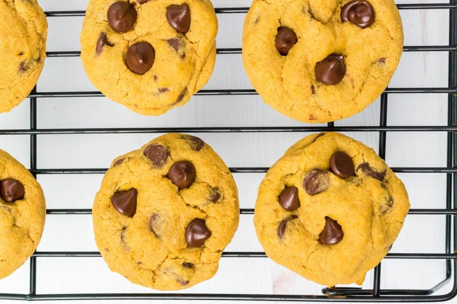 freshly baked pumpkin chocolate chip cookies on a cooling rack