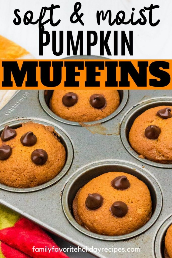 muffin pan with pumpkin chocolate chip muffins in it