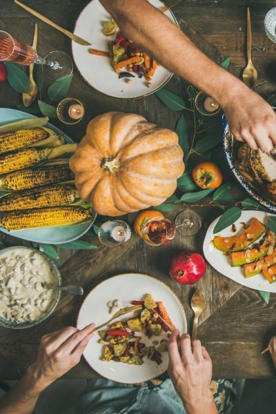 dinner table with vegan thanksgiving dishes on it