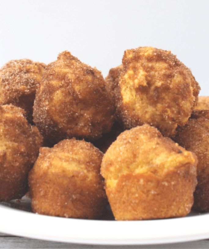 white plate with several pumpkin donut holes on it for serving