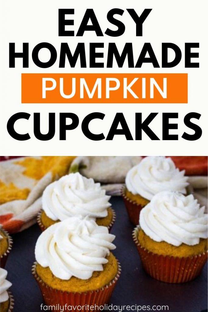 several pumpkin cupcakes on a black slate board