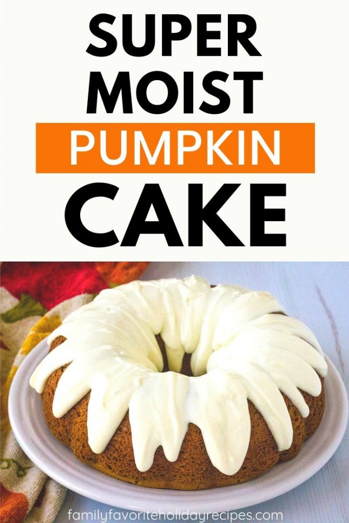pumpkin spice bundt cake on a white serving plate, topped with cream cheese frosting