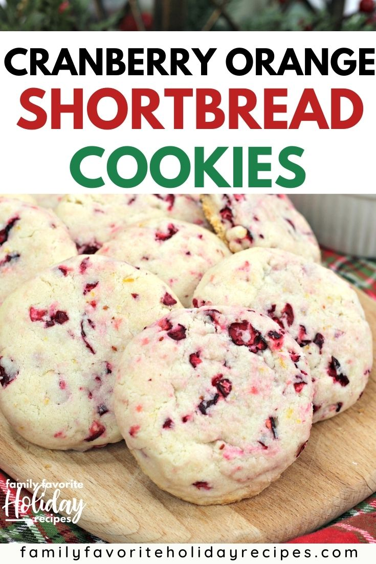 several cranberry orange shortbread cookies on a cutting board