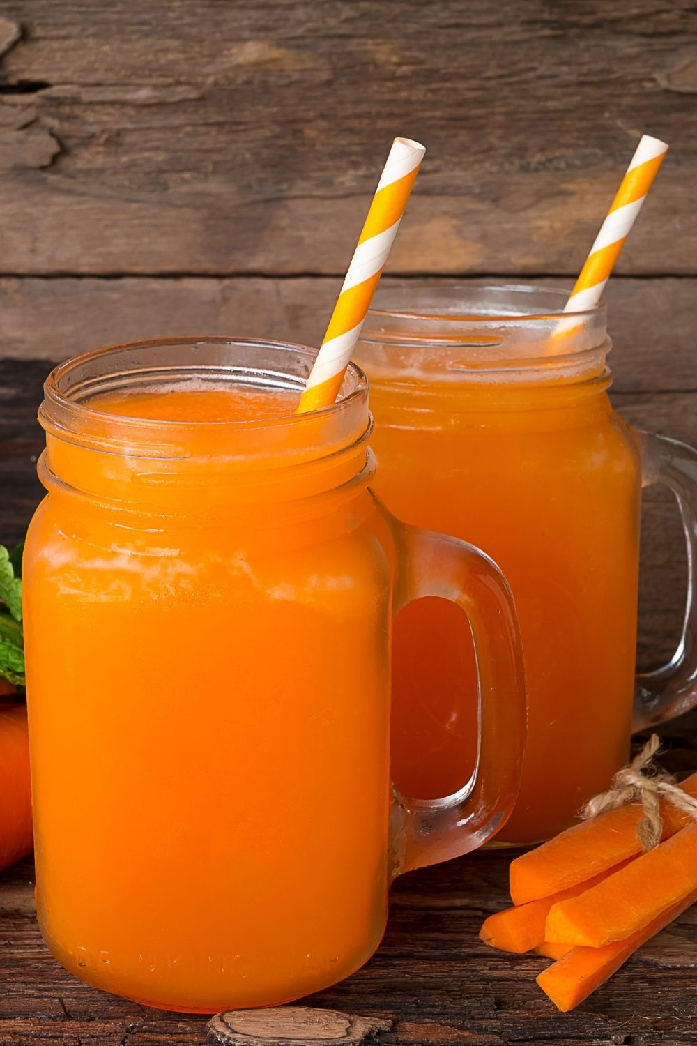 two glass mugs of carrot juice