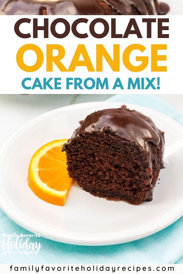 slice of chocolate orange cake on a white plate, with a sliced orange next to it